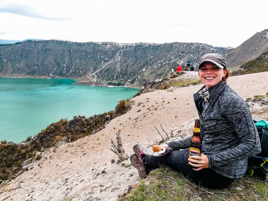 Me drinking a beer overlooking quilotoa lake