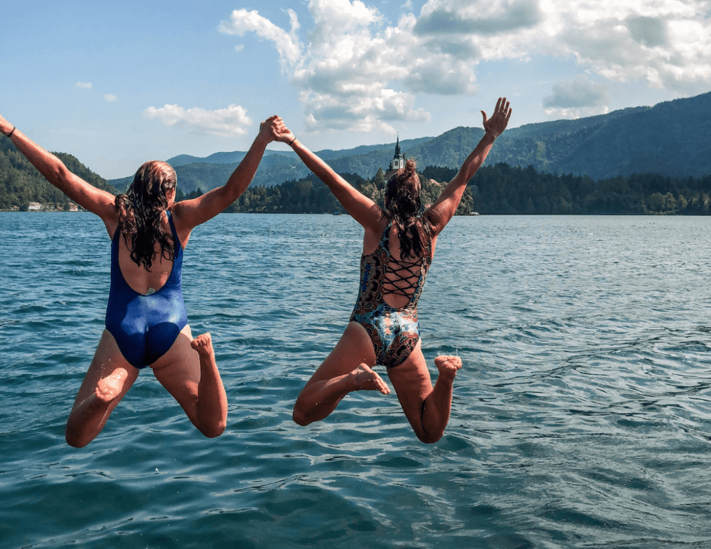 me and a friend jumping in to lake bled