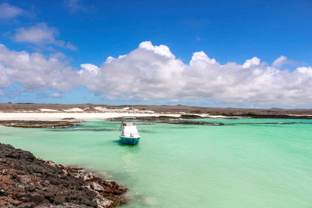 Boat in Teal Waters on San Cristobal Galapagos Islands