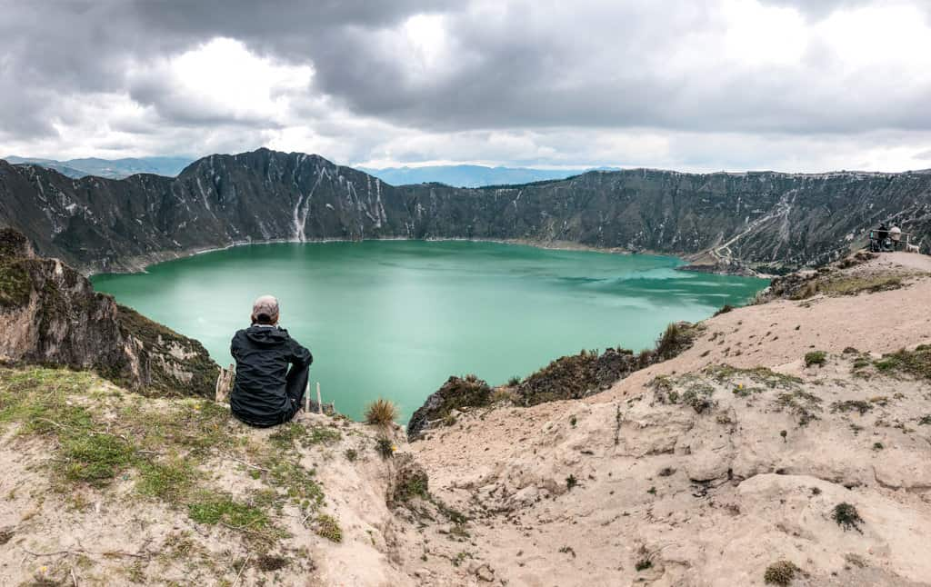 First view of the turquoise blue waters of quilotoa crater lake