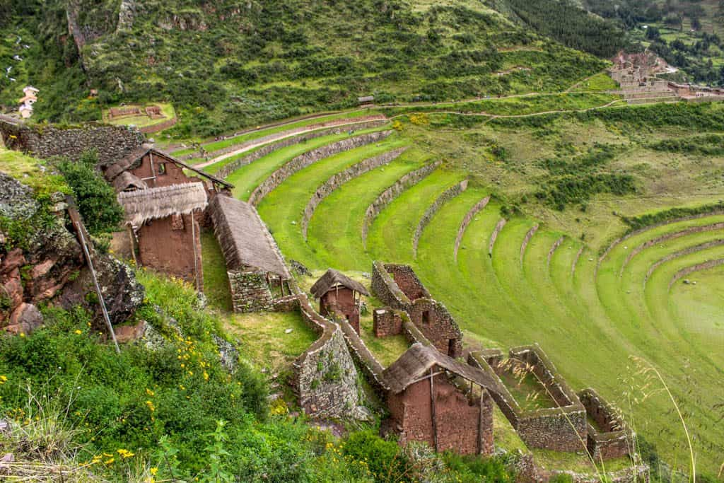 Some of the buildings of the Pisaq complex with the terraces in the background