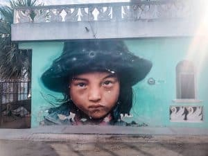 Holbox street art of a young girl