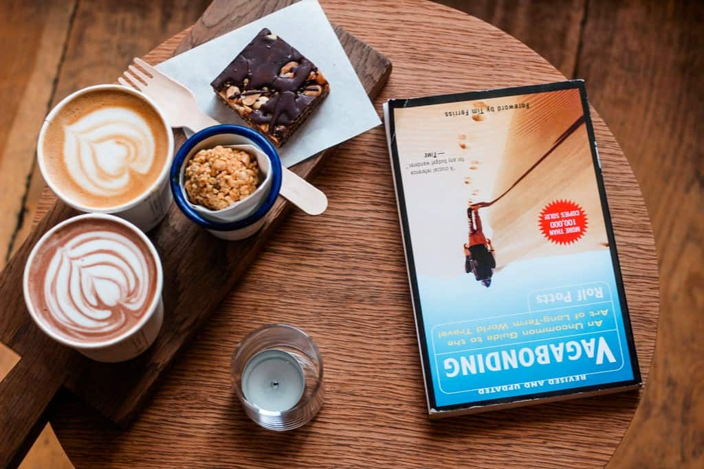 Coffee cups with a book on a table