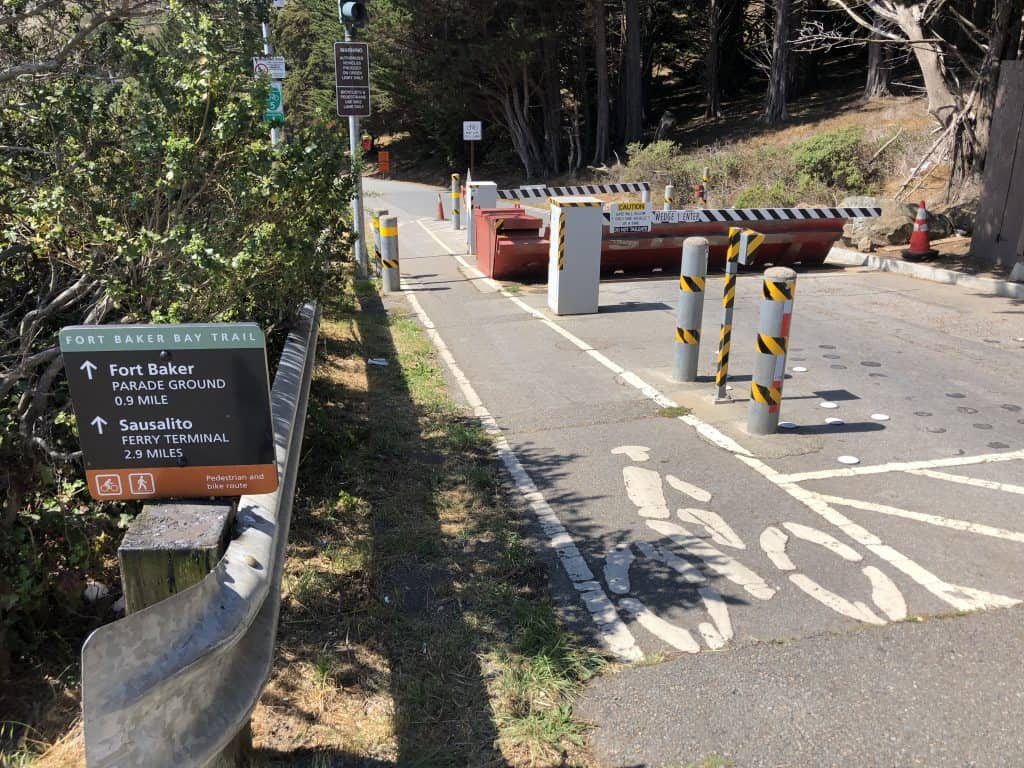A sign post directing to Sausalito and a bike road.