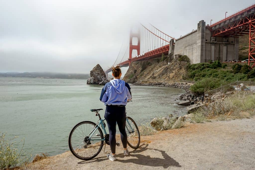 me next to a bike looking at the Golden Gate Bridge