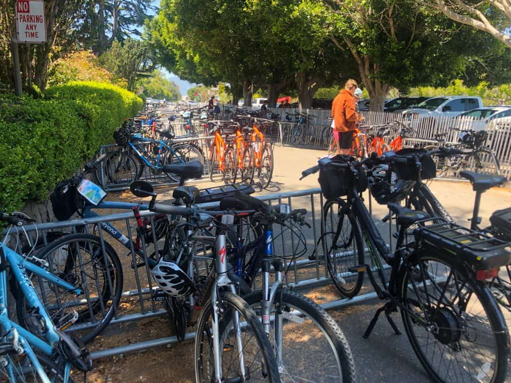 a street filled with bikes locked on bike racks in Sausalito,  CA
